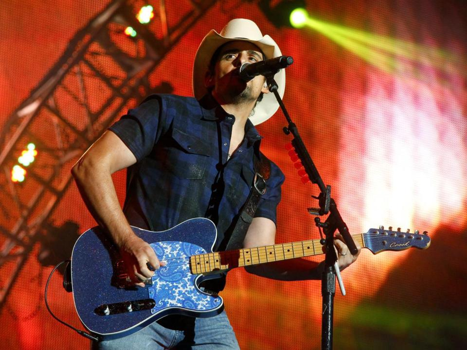 "FILE - In this June 27, 2015 file photo, Brad Paisley performs during day two of the 2015 FarmBorough Music Fest in New York. Paisley, the co-host of the Country Music Association Awards, is calling on the organization to rescind media restrictions barring reporters from asking about the mass shooting in Las Vegas, gun rights or political affiliations at the awards show. Paisley tweeted Friday, Nov. 3, 2017, that he's sure the CMA ""will do the right thing and rescind these ridiculous and unfair press guidelines"" (Photo by Andy Kropa/Invision/AP, File)"