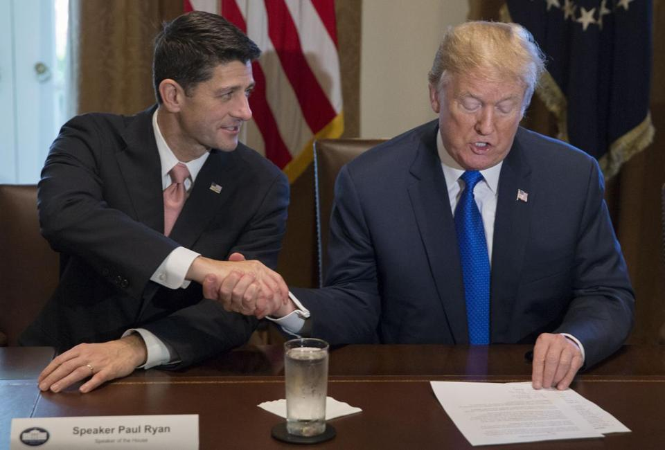 President Trump and Speaker Paul Ryan shook hands during a meeting on the GOP tax plan Thursday.
