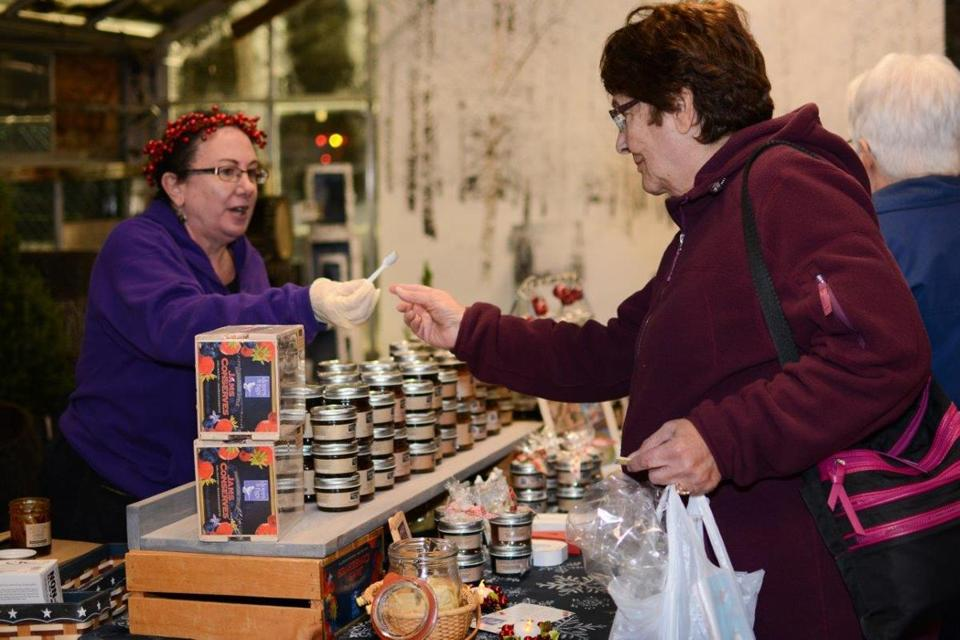 12noinformer - Vendors give out free samples in the temporarily converted greenhouse shopping center at Mahoney's Garden Center's annual Ladies' Night Out. (handout)