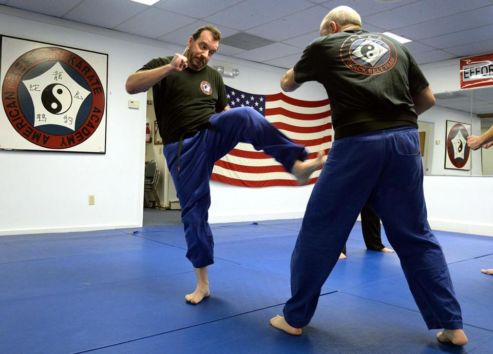 Weymouth 11/02/2017: (l-r) Jay Krim , age 49 of Rockland performs martial arts moves on Victor DeRubeis (cq) of Weymouth age 61, at the American Kempo Karate Academy in Weymouth. Photo by Debee Tlumacki for the Boston Globe (south)