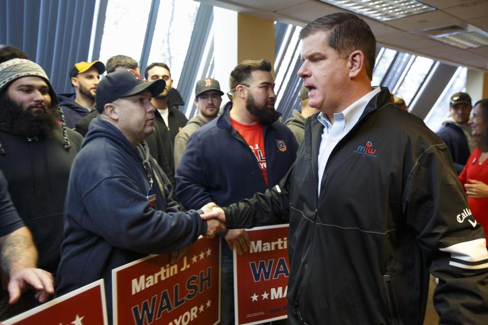 Boston Mayor Martin J. Walsh greeted supporters Saturday at his campaign headquarters in Dorchester.