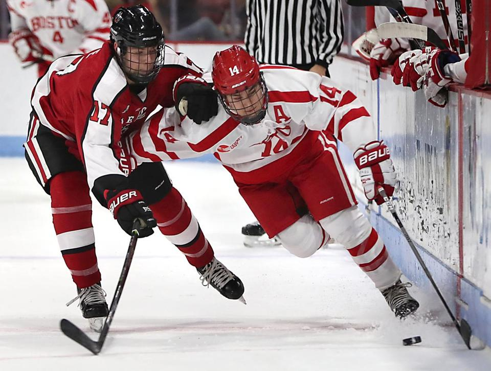 Boston Ma 11/04/17 Boston University Bobo Carpenter skates with the puck with defensive pressure from Northeastern University Matt Filipe during first period action at Agganis Arena. (Matthew J. Lee/Globe staff) topic reporter: Frank Dell'Apa