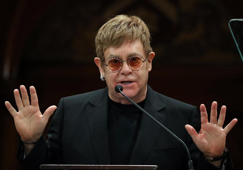 Elton John spoke to an audience of Harvard students, staff, and superfans at Sanders Theatre Monday.