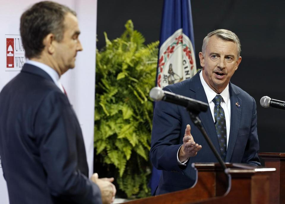 FILE - In this Oct. 9, 2016 file photo Republican gubernatorial candidate, Ed Gillespie, right, gesturing a debate with Democratic challenger Lt. Gov. Ralph Northam at University of Virginia-Wise in Wise, Va. Gillespie is trying to excite President Donald Trump's supporters with sharp-elbowed ads on immigration and Confederate statues. But he's also appealing to the more moderate electorate by talking up taxes and other pocketbook issues. (AP Photo/Steve Helber, File)
