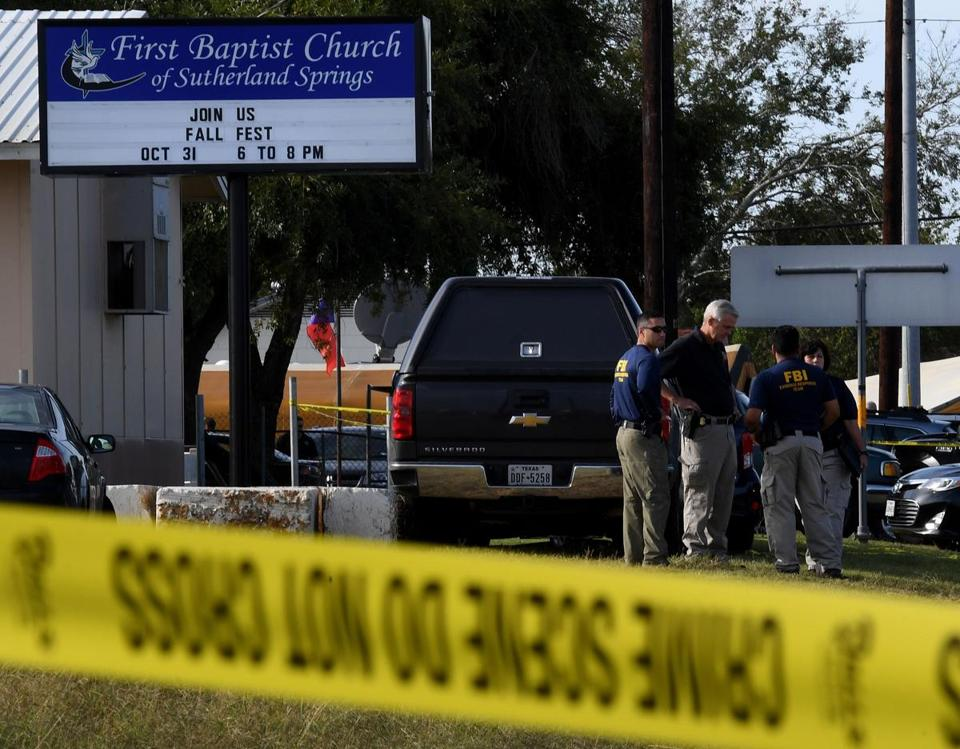 FBI agents search for clues at the entrance to the First Baptist Church, after a mass shooting that killed 26 people in Sutherland Springs, Texas on November 6, 2017. A gunman wearing all black armed with an assault rifle opened fire on a small-town Texas church during Sunday morning services, killing 26 people and wounding 20 more in the last mass shooting to shock the United States. / AFP PHOTO / Mark RALSTONMARK RALSTON/AFP/Getty Images