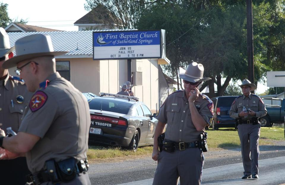 Texas Department of Public Safety troopers stood outside the First Baptist Church in Sutherland Springs, Texas, on Sunday.