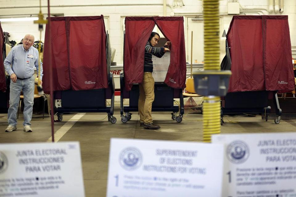 Voters cast their ballots at the fire house in Teaneck, NJ, Tuesday.