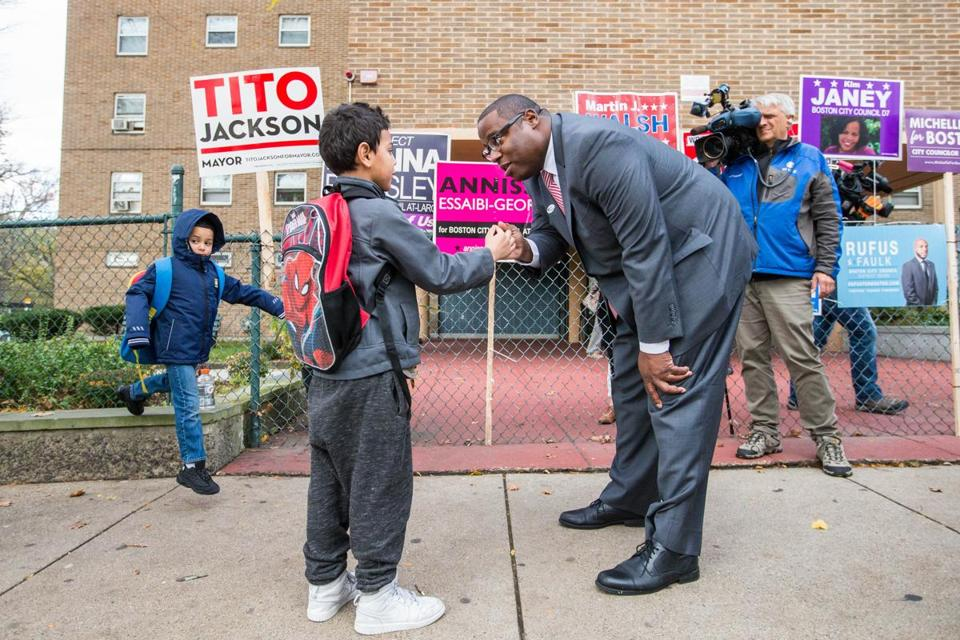 Mayoral candidate Tito Jackson spoke with children on their way to school after voting at Holgate Apartments in Boston.