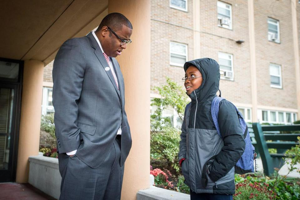Then-mayoral candidate Tito Jackson speaks with Jaheem Lawson 10, after voting at Holgate Apartments in Boston in the November 2017 city elections.