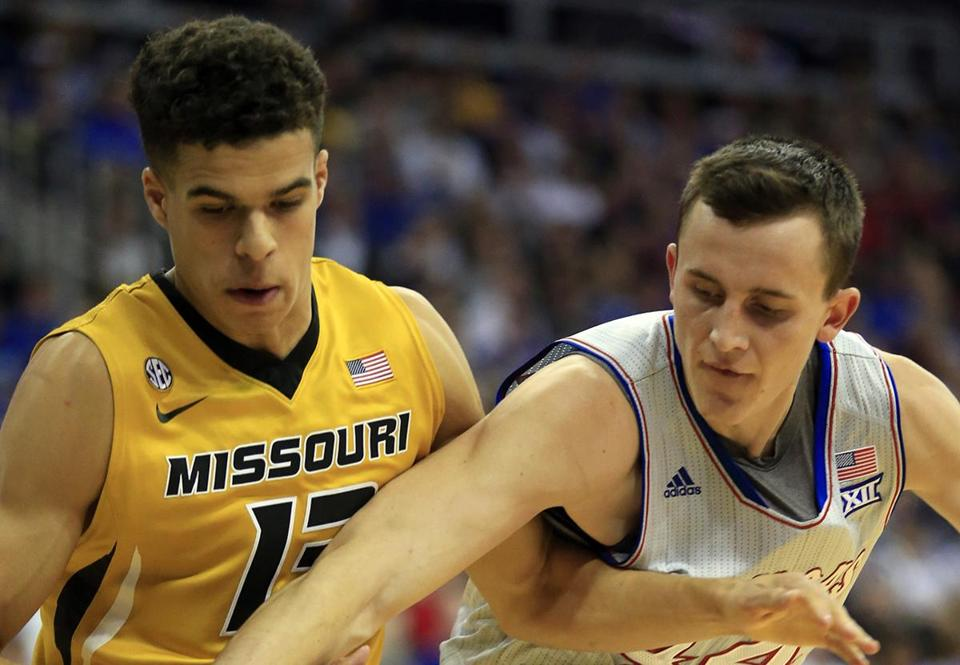 Kansas forward Mitch Lightfoot (44) reaches for the ball in front of Missouri forward Michael Porter Jr. (13) during the first half of an exhibition NCAA college basketball game in Kansas City, Mo., Sunday, Oct. 22, 2017. (AP Photo/Orlin Wagner)