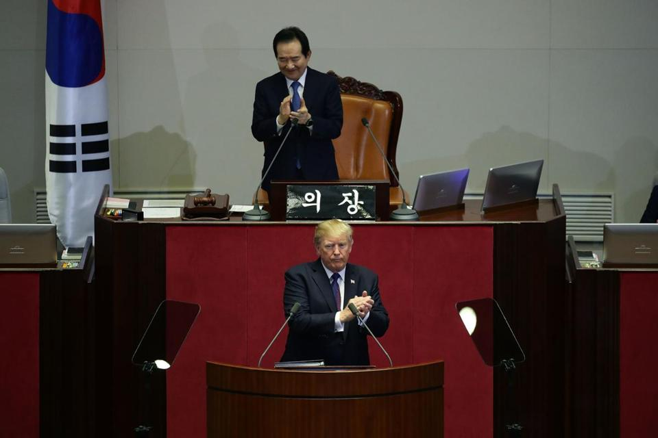 US President Donald J. Trump (bottom) clapped after speaking at the National Assembly in Seoul on Wednesday.
