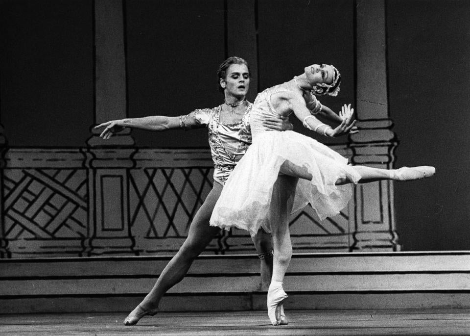 August 1980: Ballet dancers Mikhail Baryshnikov and Lesley Collier perform a pas de deux in 'Rhapsody' at Covent Garden in London. Choreography was by Sir Frederick Ashton and music by Sergei Rachmaninoff. (Photo by Mike Lawn/Evening Standard/Getty Images)