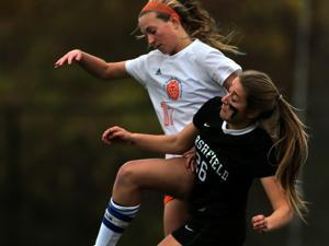 Newton, MA - 11/07/17 - Marshfield's Lily O'Sullivan vies with Newton South's Maddy Yorke in the Division 1 South girls' soccer quarterfinal. (Lane Turner/Globe Staff) Reporter: (Nathaniel Weitzer) Topic: (08schnewtonsouth)