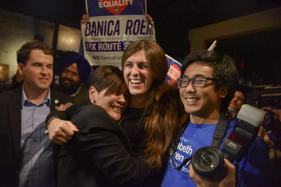 Danica Roem, center, who ran for house of delegates against GOP incumbent Robert Marshall, was greeted by supporters as she prepared to give her victory speech on Nov. 7.