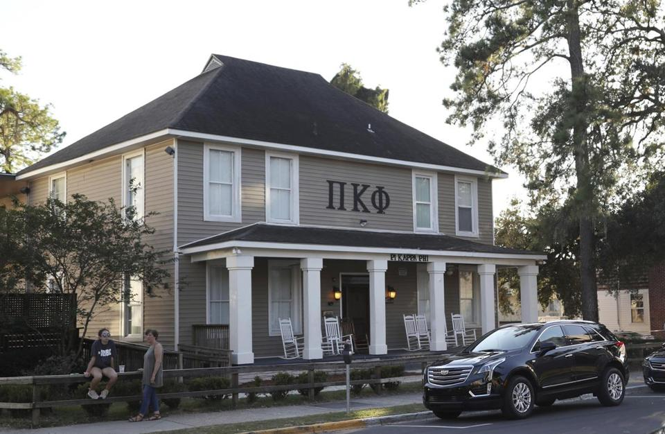 In this photo taken Nov. 3, 2017, Florida State University's Pi Kappa Phi fraternity house near the FSU campus in Tallahassee, Fla., is viewed. Florida State President John Thrasher announced during a news conference at FSU on Monday the suspension of all Greek life activities at the university following the death at a Pi Kappa Phi fraternity pledge. (Joe Rondone/Tallahassee Democrat via AP)