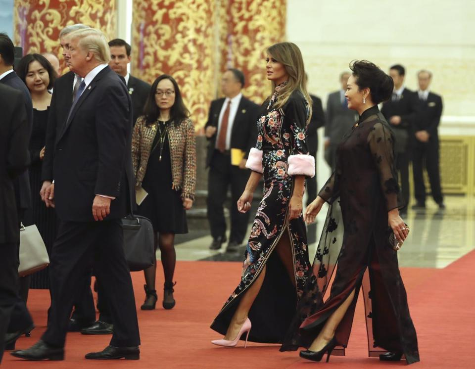 Melania Trump walked with Peng Liyuan (right), wife of Chinese President Xi Jinping into the state dinner.