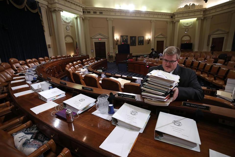 Staffer Thomas Kutz handed out papers before the start of the House Ways and Means Committee markup of the Republicans tax reform plan titled the Tax Cuts and Jobs Act., on Capitol Hill on Thursday.
