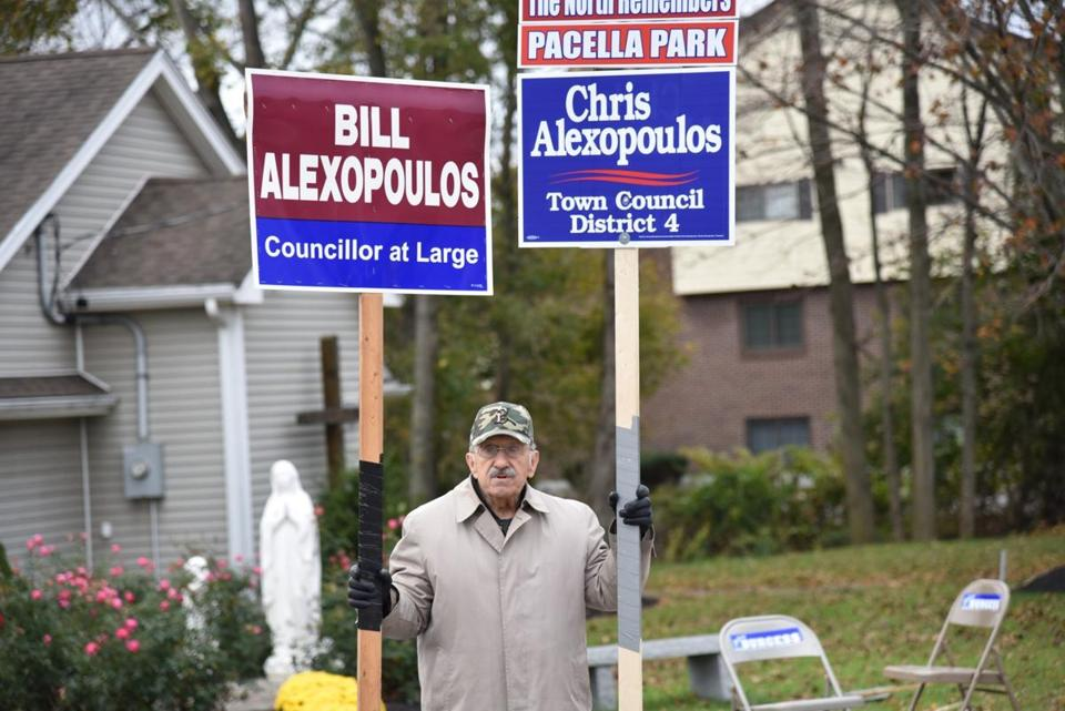 12sobrfrandolph - Nicholas Orphanos holds signs outside of St. Bernadette Church in Randolph for his son-in-law Bill Alexopoulos and grandson Chris Alexopoulos who both won seats on the town council 11/7. (Handout)