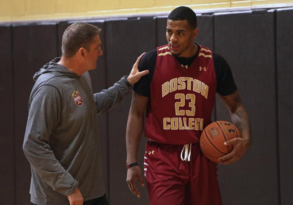 BC coach Jim Christian shares a reassuring word with Deontae Hawkins.