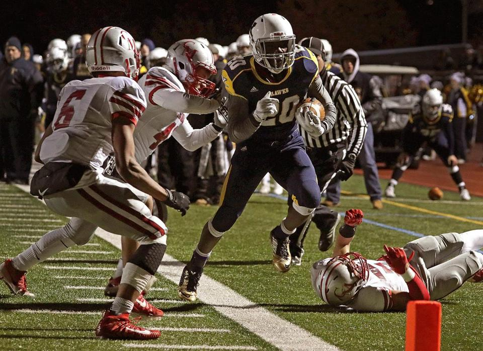 Westwood, MA - 11/10/2017 - Xaverian RB Ikechukwu Irabor (20), is pushed out of bounds after a run for first down just short of the end zone on the team's first touchdown drive in the first quarter. Xaverian vs. Catholic Memorial in Division 1 South football semifinal.- (Barry Chin/Globe Staff), Section: Sports, Reporter: Owen Pence Topic: 11schxaverian, LOID: 8.4.12170797.