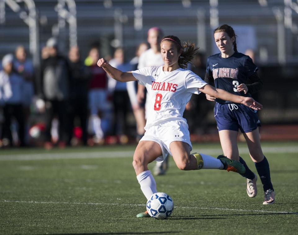 Lynn, MA - 11/12/2017 - Amesbury #8 Ashley Pettet passing the soccer ball midfield. Saint Joseph's prep #3 Kerry McMullan (right) (John Cetrino for The Boston Globe) Sports Reporter Jonathan Sigal