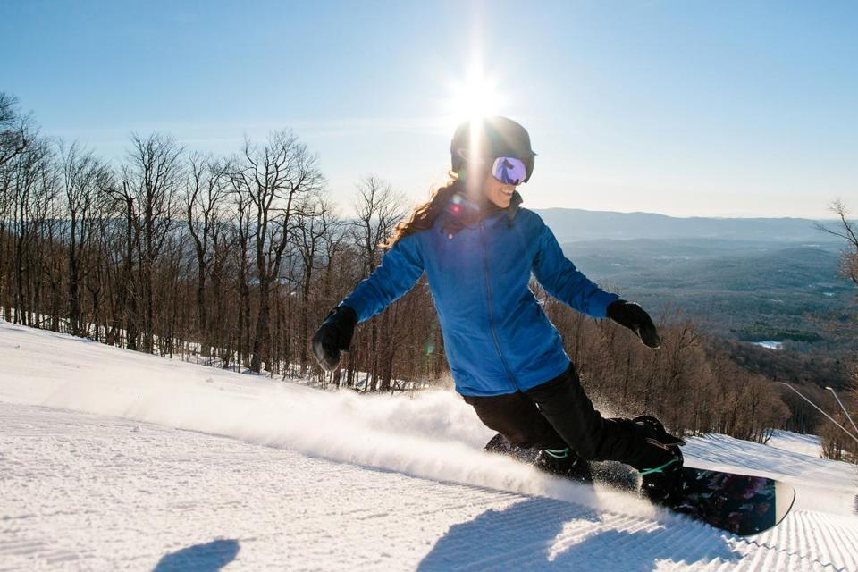 A snowboarder at Bromley Mountain Ski Resort in Vermont.