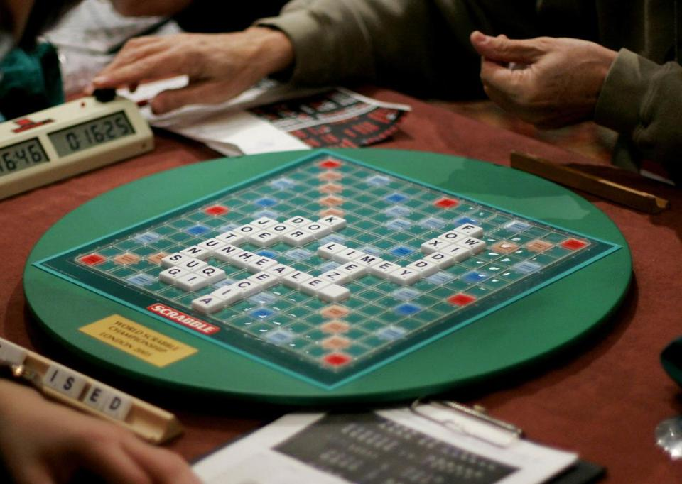 One of the world's leading Scrabble players and former UK national champion has been banned from playing the game competitively for three years due to accusations of cheating.