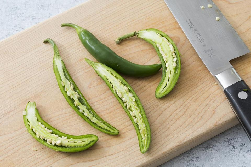 The compound that makes fresh chilies spicy hot, capsaicin, is most concentrated in the pith and ribs inside the chili. There's a little less in the seeds, and the flesh has the lowest concentration.