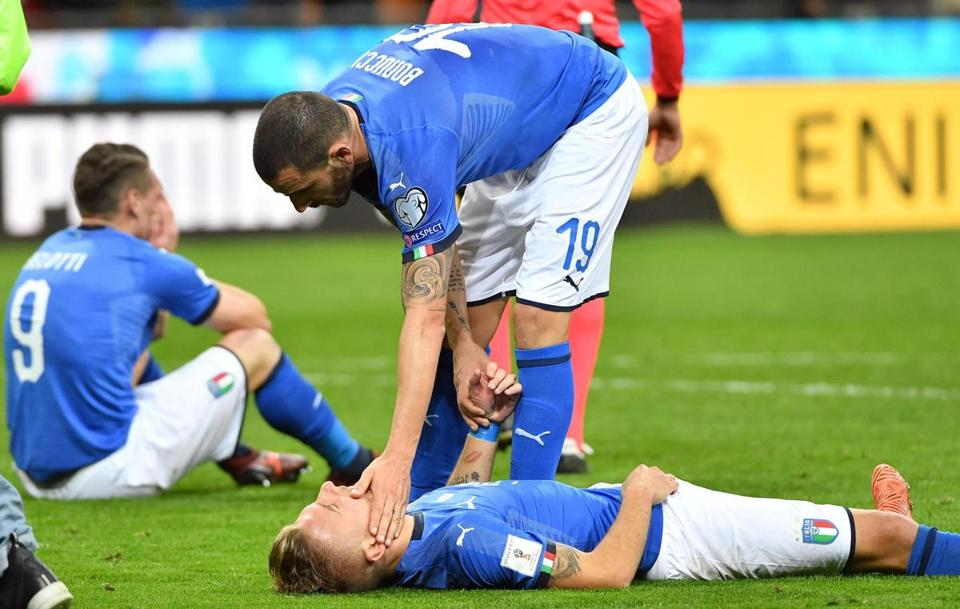 Mandatory Credit: Photo by DANIEL DAL ZENNARO/EPA-EFE/REX/Shutterstock (9221382bp) Italy's defender Leonardo Bonucci and teammate forward Ciro Immobile show their dejection at the end of the FIFA World Cup 2018 qualification playoff second leg soccer match between Italy and Sweden at the Giuseppe Meazza stadium in Milan, Italy, 13 November 2017. Sweden won 1-0 on aggregate. Italy vs Sweden, Milan - 13 Nov 2017