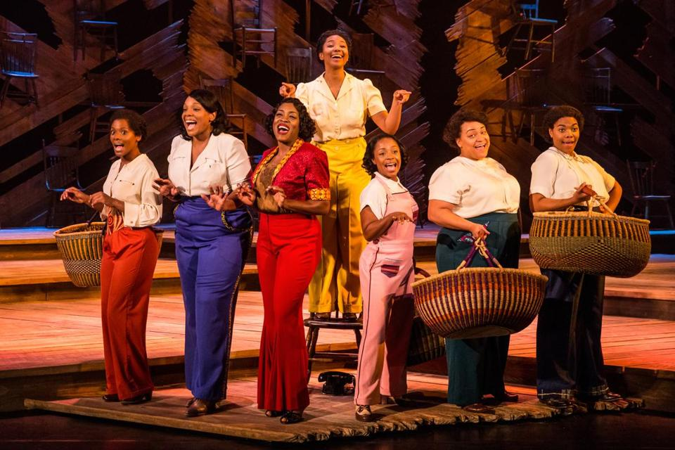 "Adrianna Hicks (on chair) and the touring production cast of ""The Color Purple."""