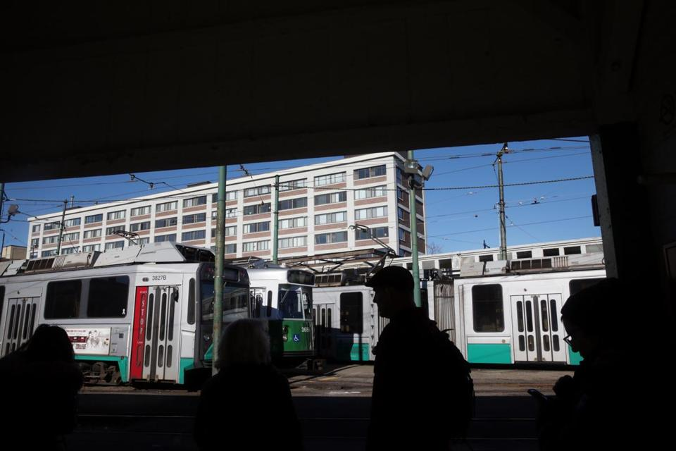 Commuters waited for a Green Line train at Lechmere Station in Cambridge on Friday. GLX Constructors, a joint venture of several engineering and construction firms, will design and build the Green Line extension.