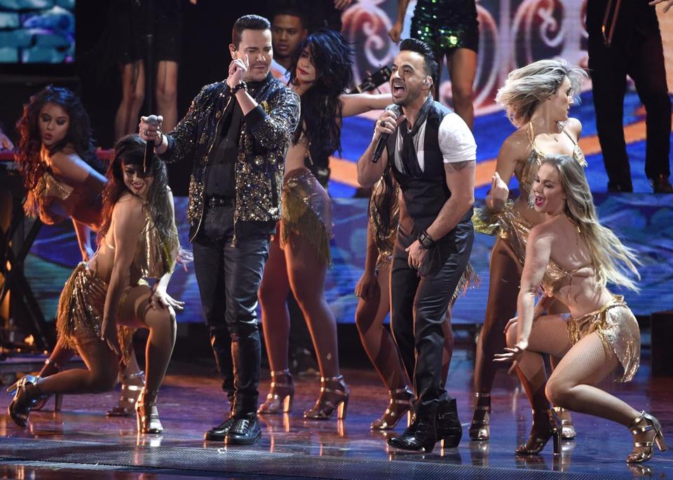 "Victor Manuelle, left, and Luis Fonsi perform ""Despacito"" at the 18th annual Latin Grammy Awards at the MGM Grand Garden Arena on Thursday, Nov. 16, 2017, in Las Vegas. (Photo by Chris Pizzello/Invision/AP)"