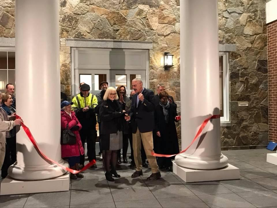 Building Commissioner Bill Casbarra and town employee Deborah Cochran were chosen to cut the ribbon at Foxborough's new town hall on Nov. 14.