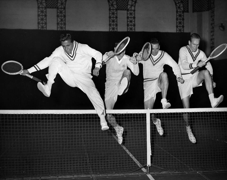 From left, Mr. Segura, Bobby Riggs, Dinny Pails, and Jack Kramer leaped a net at an indoor court in New York City in 1947 as they prepared for matches.