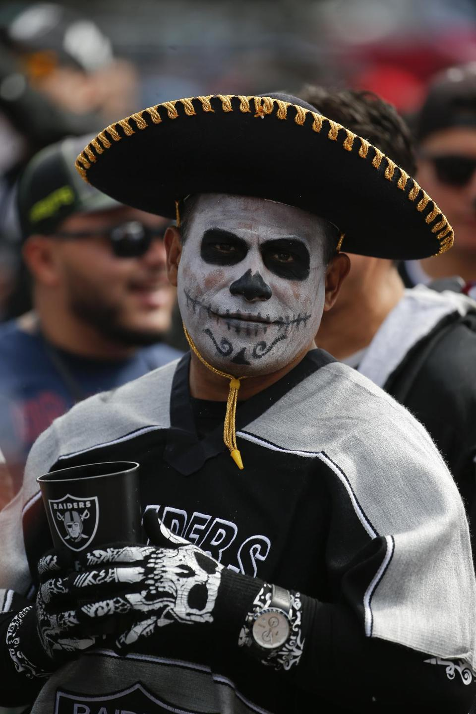 A Raiders fan looks on before the Raiders face the Patriots.
