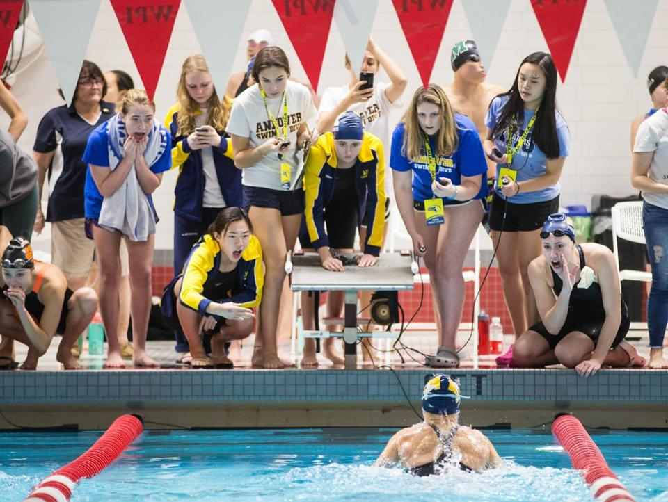 Andover teammates cheered for Jordan Clements as she won the 100-yard breaststroke.
