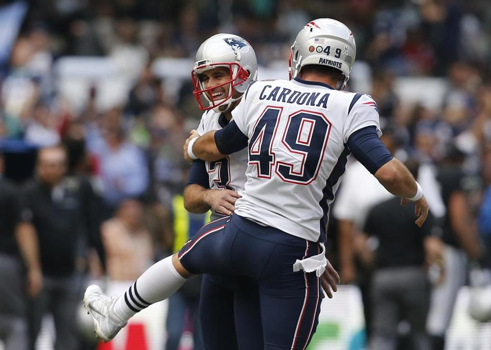 Mexico City, Mexico -- 11/19/2017 - New England Patriots kicker Stephen Gostkowski celebrates with Joe Cardona (R) after making a 62 yard field goal against the Oakland Raiders during the second quarter of their 2017 NFL Mexico Game at the Estadio Azteca. (Jessica Rinaldi/Globe Staff) Topic: Patriots Reporter: