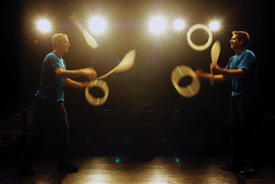 The Amazing Nano Brothers Juggling Show, featuring comics Dan Foley (left) and Joel Harris (right), comes back to the Boston Museum of Science. In this scene, the rings and clubs represent the 0's and 1's of computer code scientists use to gather data.