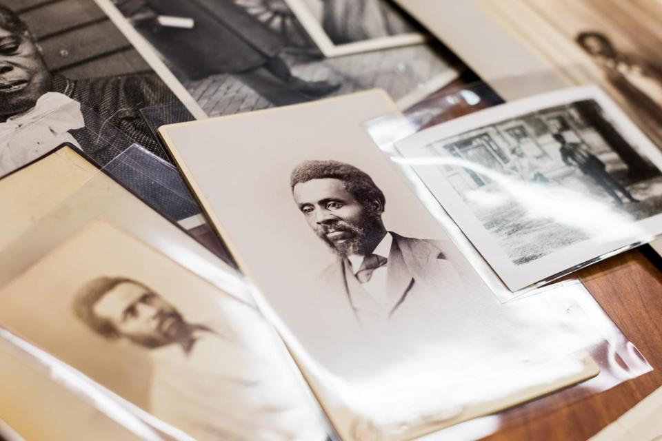 Photographs of Samuel Osborne (center) and his family were displayed in the Colby College archive.