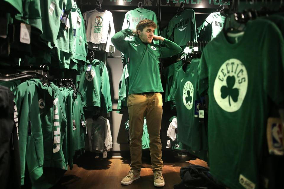 "Boston, MA - 11/21/17 - Jeff Lentz (cq), of Bay City, Michigan, checks out Celtics gear at the Boston ProShop in TD Garden. He was in town visiting his brother. ""It's pretty hard to be a Pistons fan right now,"" he said, explaining why a Michigan guy was buying Celtics merchandise. (Lane Turner/Globe Staff) Reporter: (Levenson) Topic: (22celtics)"