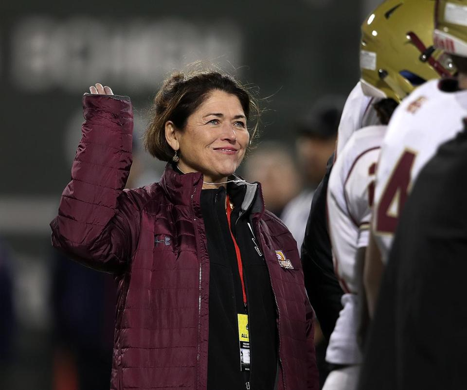 Boston, MA: 11-21-17: TO GO WITH KEVIN CULLEN STORY........Boston College High School headmaster Grace Regan is pictured as she waves while being introduced on the field before the game. Boston College High School took on Catholic Memorial High School in a football game held at Fenway Park. (Jim Davis/Globe Staff)