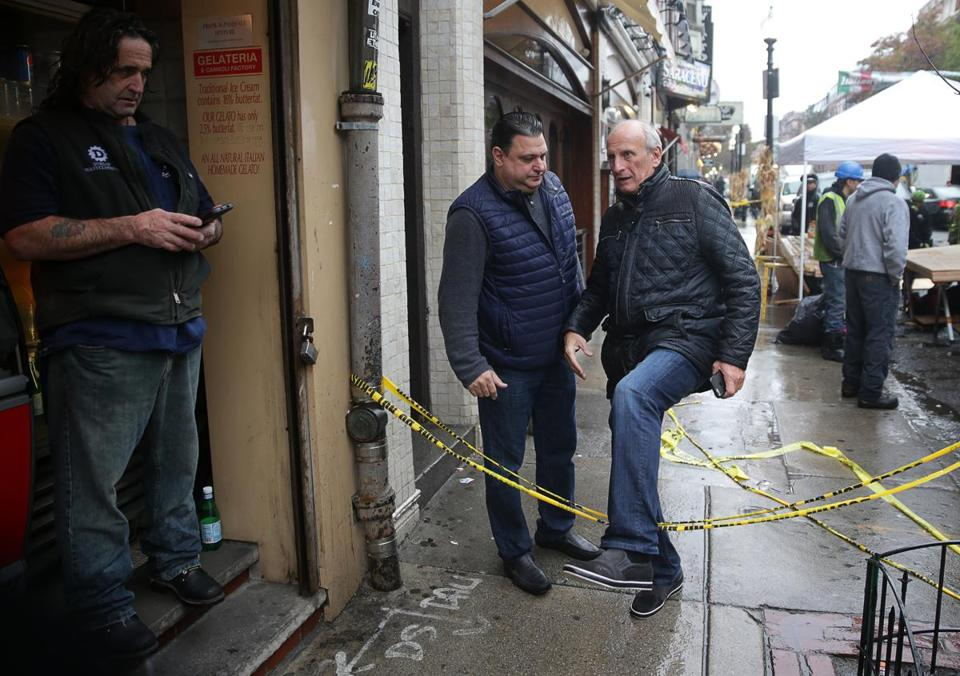 11/22/2017 Boston - Ma - Frank DePasquale (cq) the owner of Trattoria Il Panino steps over tape after fire aftermath at 282 Hanover Street in Boston's North End. His restaurant is at 280 Hanover Street which is adjoined to build that was the scene of a tragic fire. Jonathan Wiggs\Globe Staff Reporter:Topic.