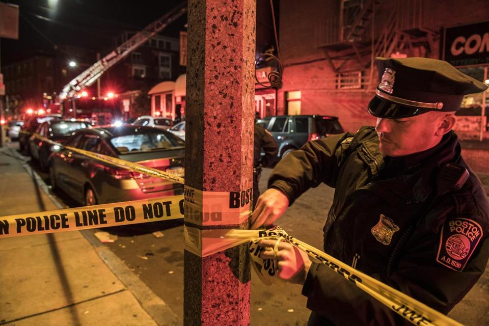 A Boston police officer cordoned off the scene.