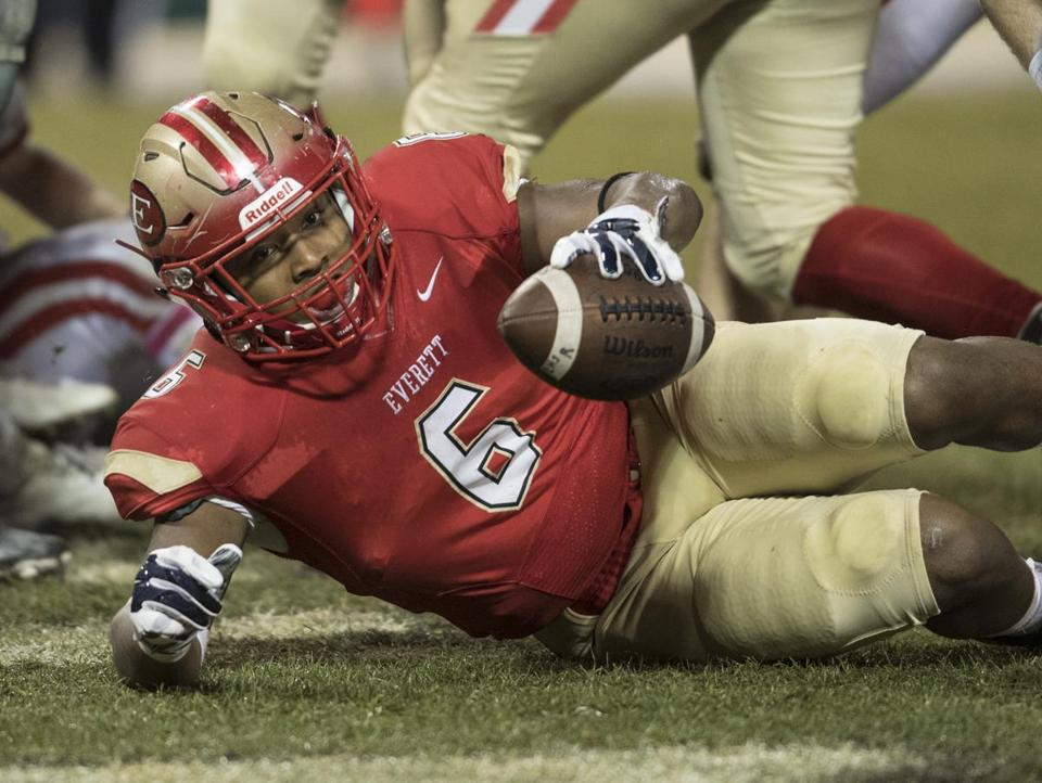 Boston , MA - 11/22/2017 -Everett #6 Kevin Brown Rushing touchdown first quarter. Masconomet Regional vs. No.. 1 ranked Everett (John Cetrino for The Boston Globe) Sports