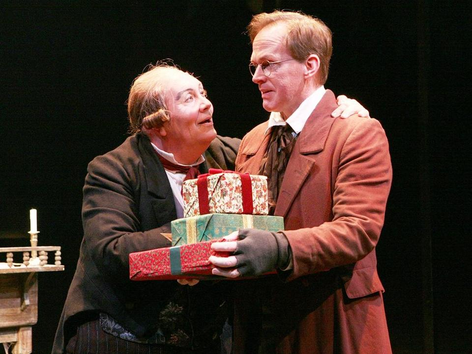 David Coffee (Ebenezer Scrooge) and Russell Garrett (Bob Cratchit) in A CHRISTMAS CAROL at North Shore Music Theatre - Dec 8 - 23. Photo©Paul Lyden