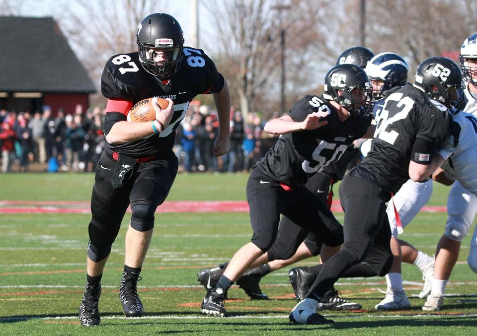 Marblehead, MA: 11-23-2017: With his teamates blocking, Marblehead's Andy Clough (no. 87) has a clear path to the end zone during the third quarter of the Thanksgiving Day football game between against Swampscott at Marblehead High School in Marblehead, Mass., Nov. 23, 2017. This made the score 34-17. Photo/John Blanding, Boston Globe staff story/Owen Pence( 24schmarblehead )