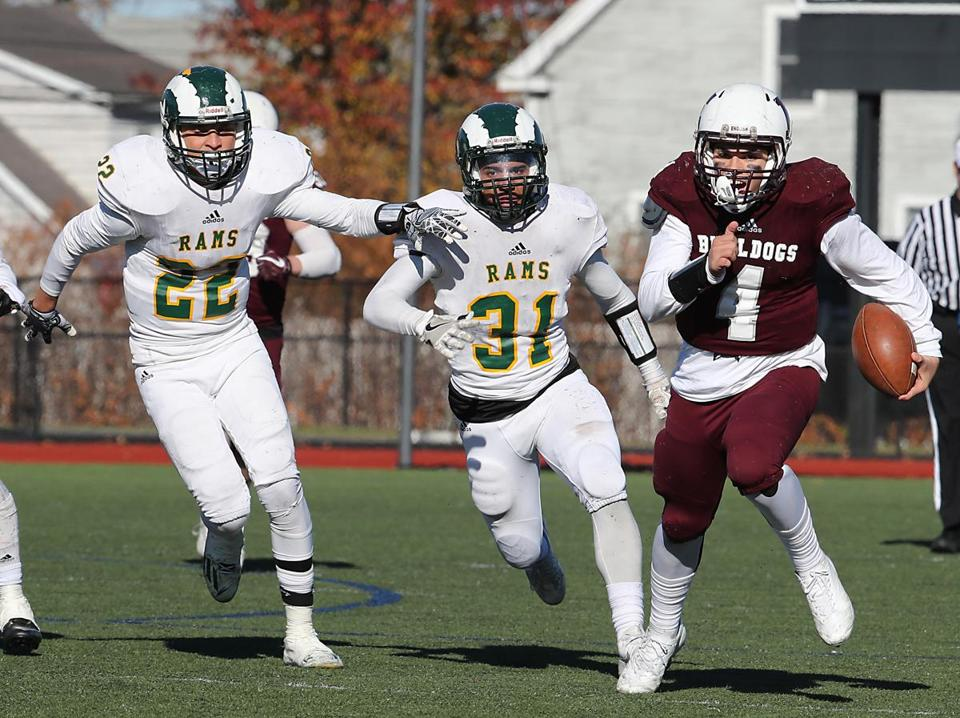 Lynn English's Mathias Fowler pulls away from Lynn Classical defenders Maurice Sequera (22) and Alberto Guerrero.