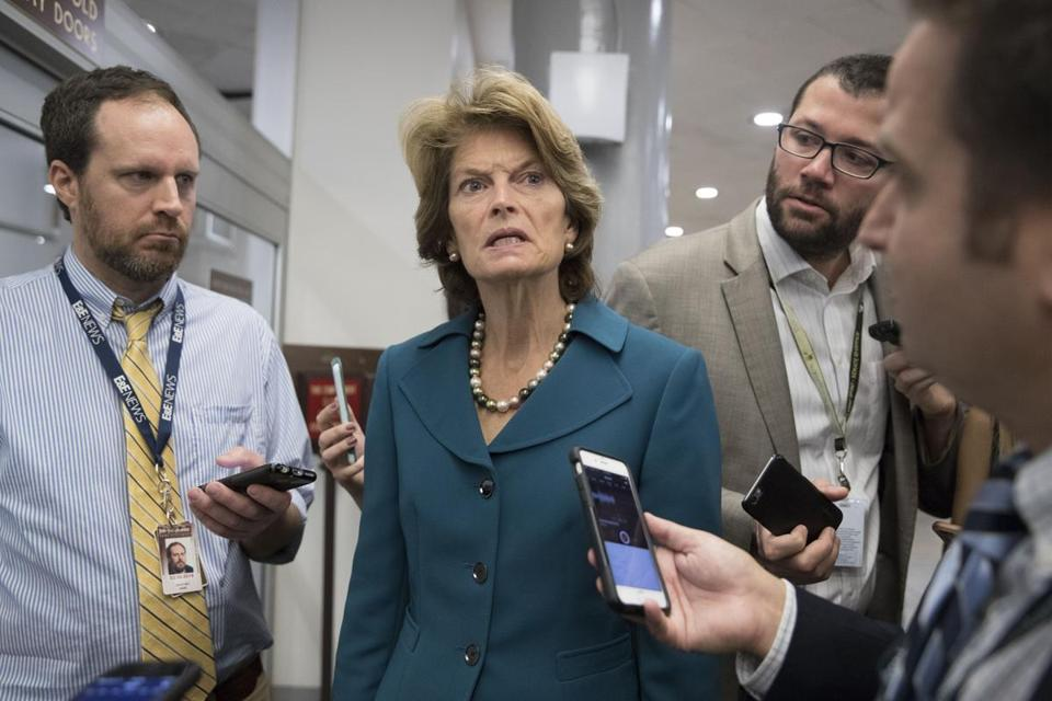 Mandatory Credit: Photo by MICHAEL REYNOLDS/EPA-EFE/REX/Shutterstock (9140975k) Lisa Murkowski US Senators before a procedural vote to advance debate on tax reform, Washington, USA - 17 Oct 2017 Republican Senator from Alaska Lisa Murkowski (C) speaks to members of the news media at the Senate subway before a procedural vote to advance debate on tax reform, on Capitol Hill in Washington, DC, USA, 17 October 2017.