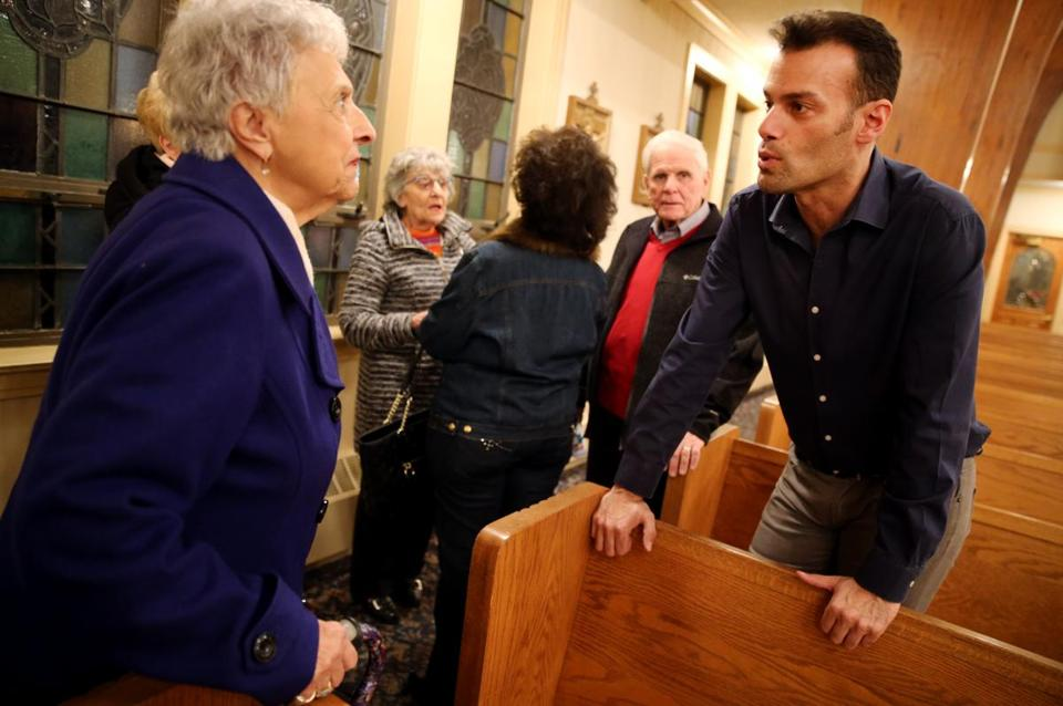 Andrew Giordano talks with Susan Stazzere following a church service at St. Barbara Parish Church in Woburn.