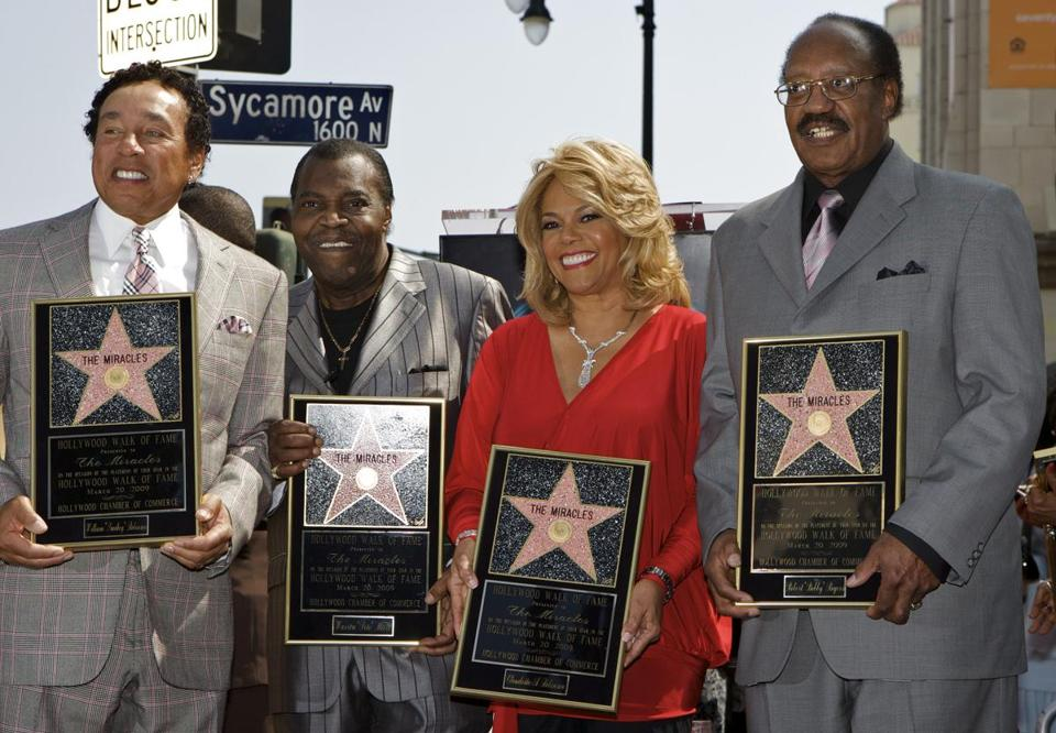 Miracles (from left) Smokey Robinson, Mr. Moore, Claudette Robinson, and Bobby Rogers at the Hollywood Walk of Fame.
